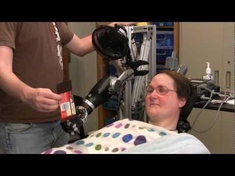 One Giant Bite: Woman with Quadriplegia Feeds Herself Chocolate Using Mind-Controlled Robot Arm